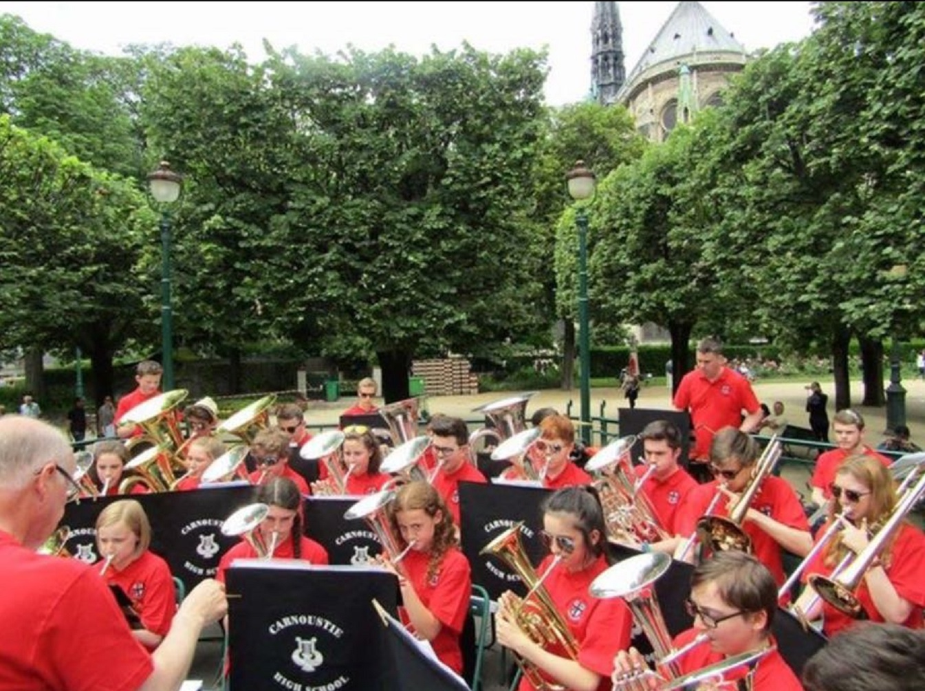 The Carnoustie band performing in front of the Notre Dame Cathedral in Paris