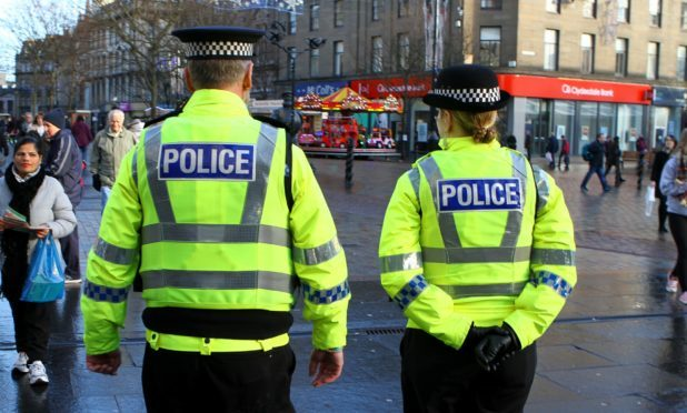 Police patrol in Dundee city centre.