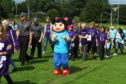 Walkers on the Relay for Life at Morgan Rugby Club.