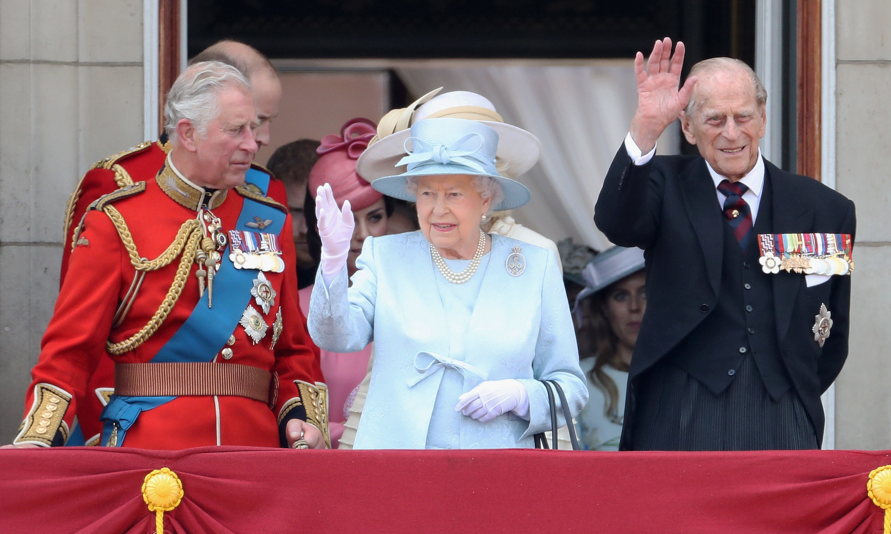 Prince Charles, Queen Elizabeth II and Prince Philip look out from the balcony of Buckingham Palace during the Trooping the Colour parade on June 17, 2017 in London.