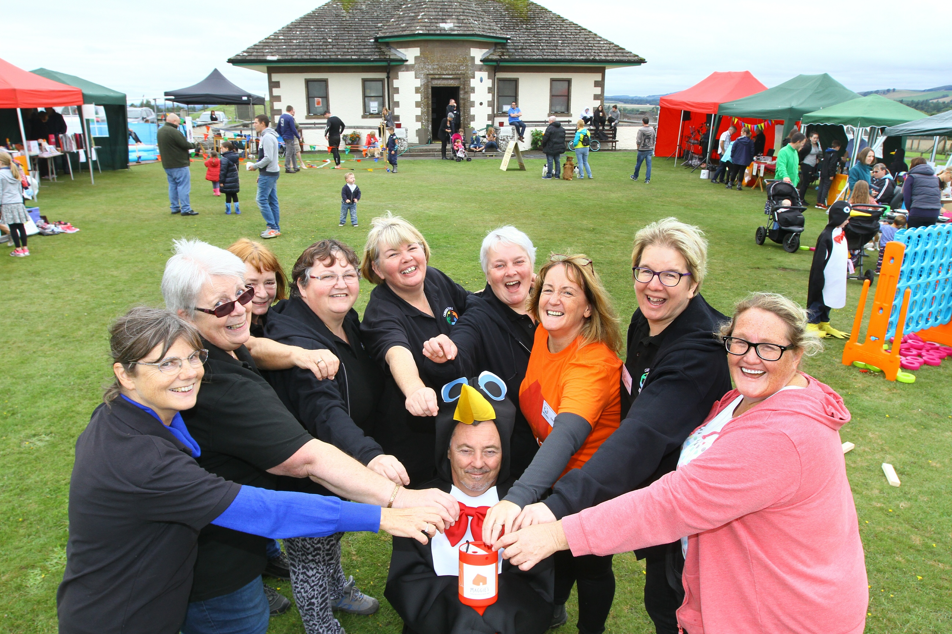 The girls of the Kirrie Regeneration Group put money in Mr Penguins (Bill McGlaughlin's) tin.  £1,200 was raised.