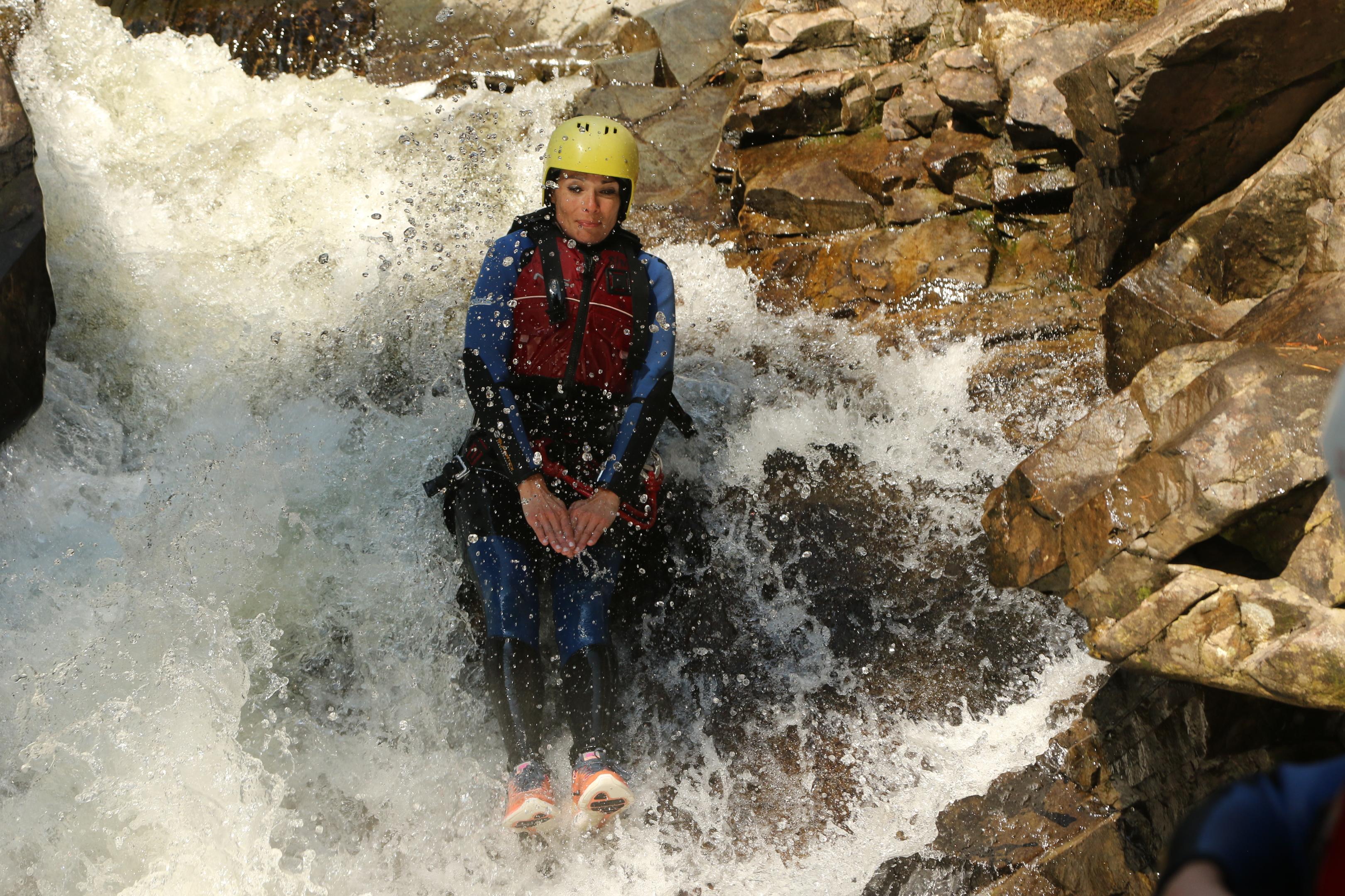 Gayle enjoying a natural slide during a gorge walking session with Nae Limits.