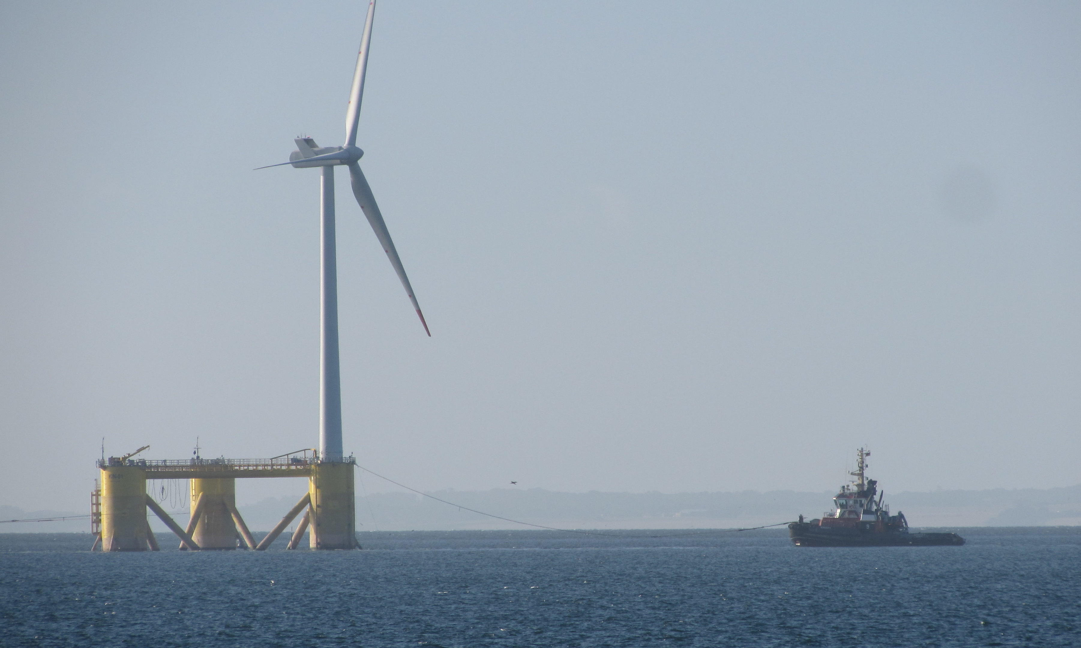 The offshore wind turbine makes its way down the Tay.