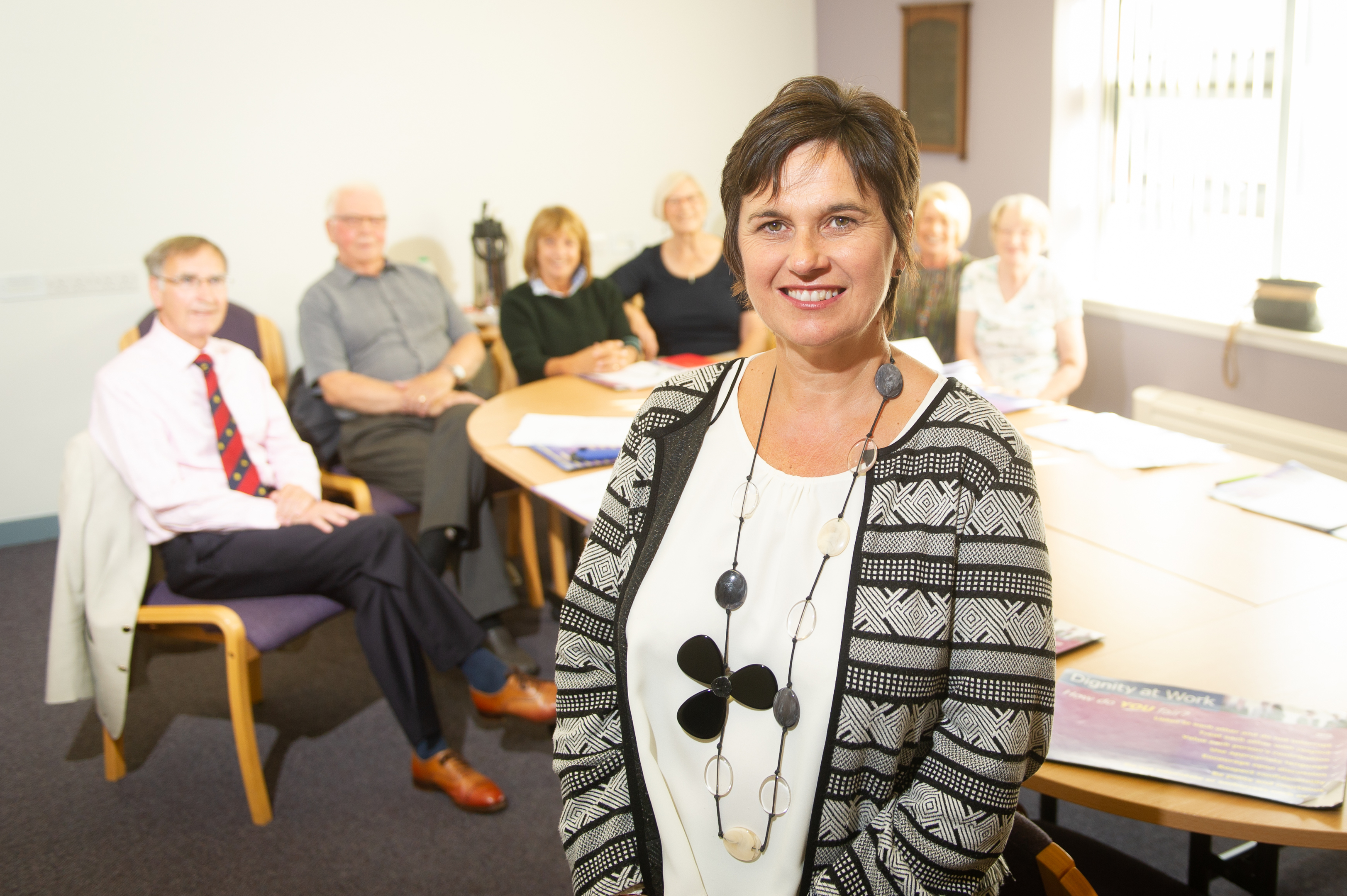 Elaine Colville with members of Lippen Care's executive committee at the Strathmore Hospice in Forfar.