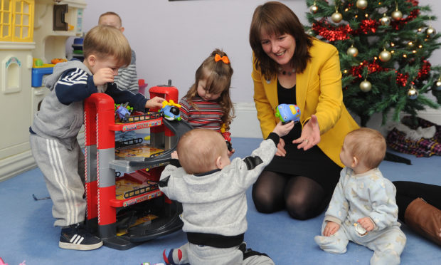 Minister for Childcare and Early Years, Maree Todd, with some local youngsters.