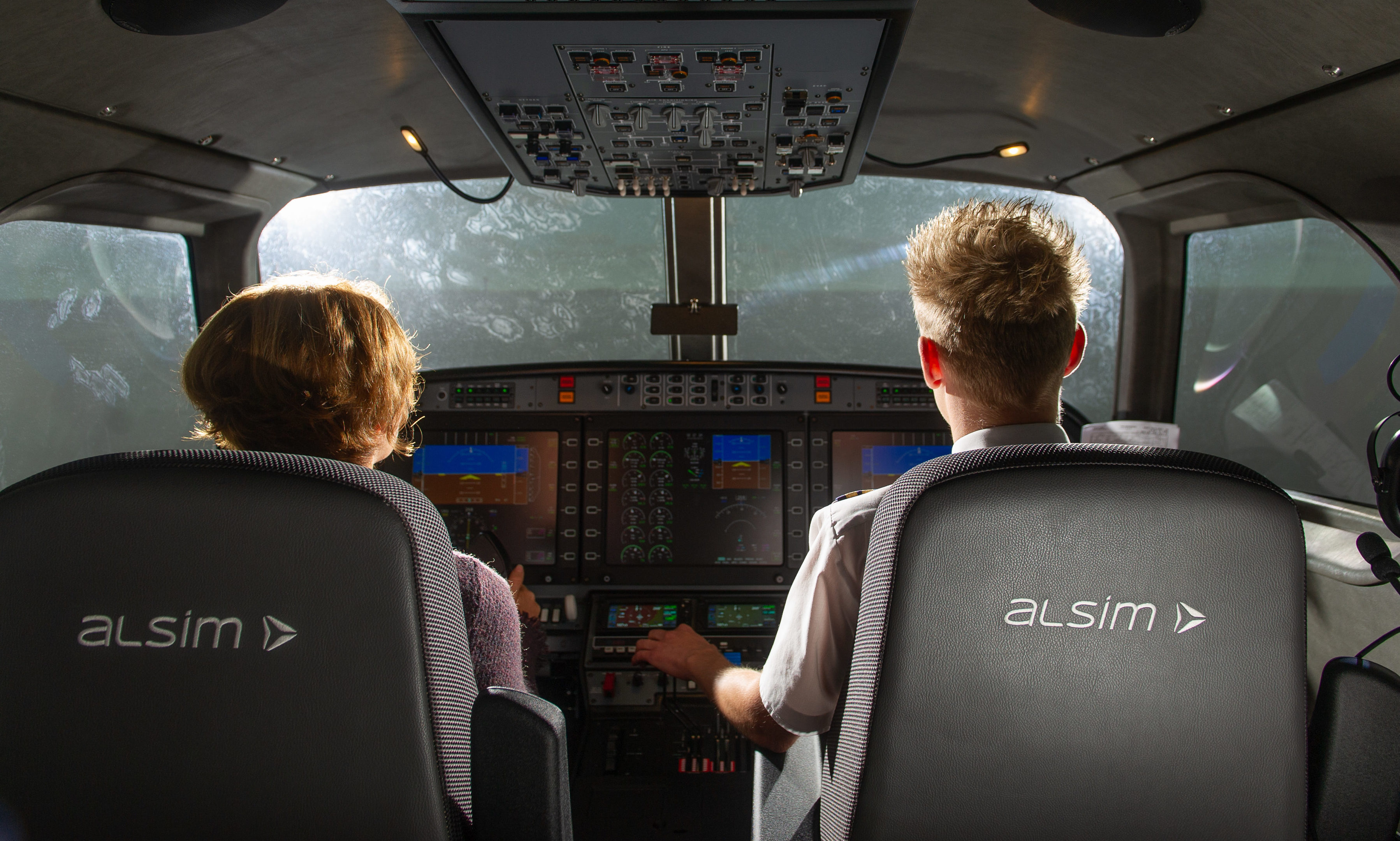 Caroline Strain and pilot Gavin Ritchie on the flight simulator.