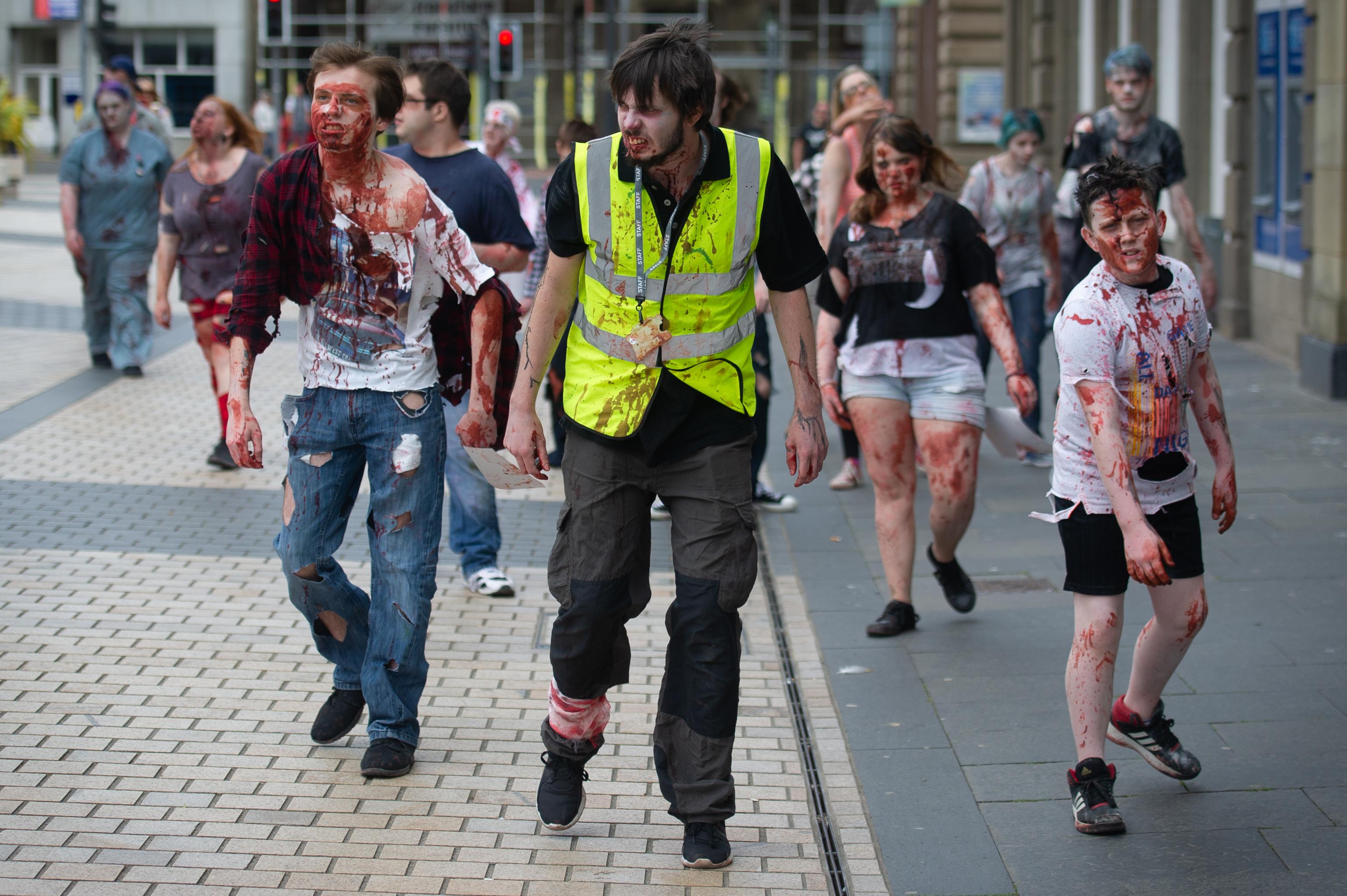 Zombies walk through Meadowside on Saturday