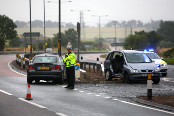 A two-car accident at the Tealing junction