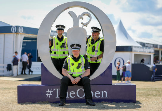 Sgt Peter Lorrain-Smith, Insp Stephen Hunter and Sgt Terry Reid in the tented village at The Open.