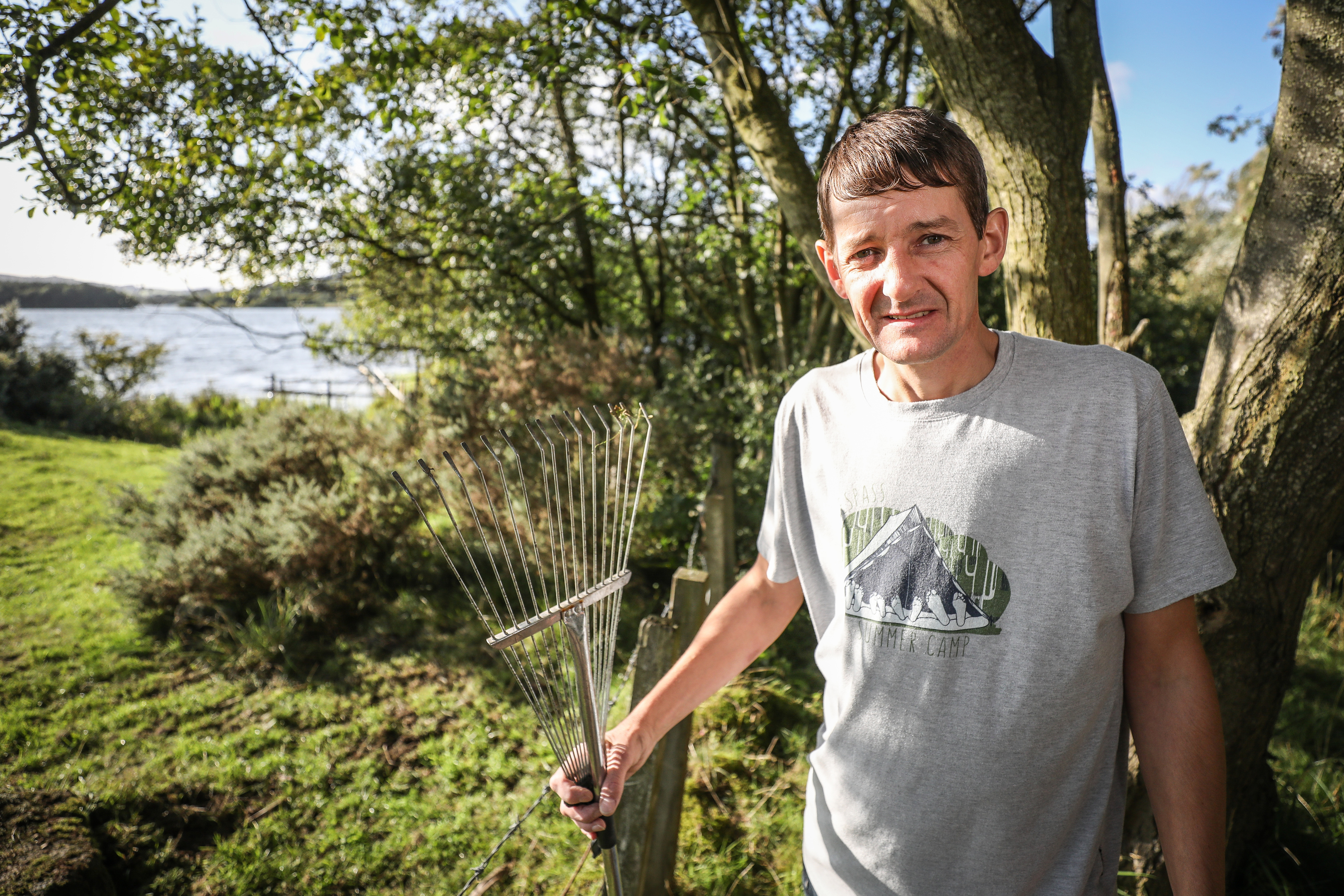 Tam Cotter with his rake near where the attack happened.