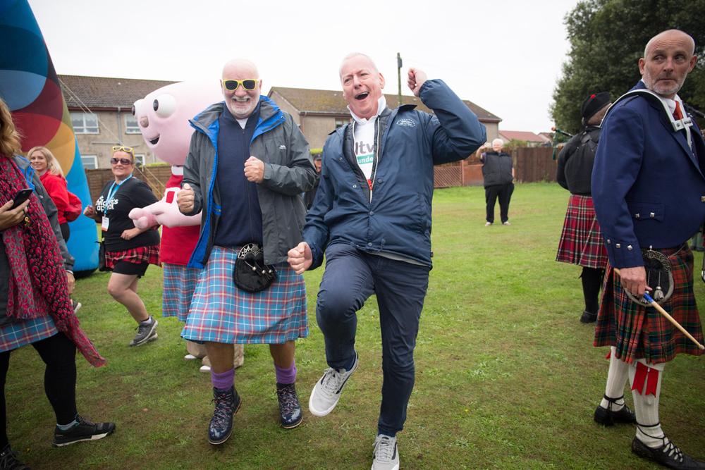 Jim White and Sir Tom Hunter enjoying the stroll.