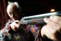 Master gun-engraver Malcolm Appleby is reunited with his 'Pheonix' gun prior to its auction at Gleneagles.