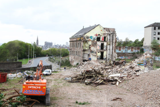 Central Demolition at work on Halley's Mill in May,