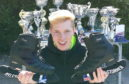 Myles Storrier with his skates and trophies.