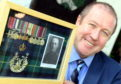 Veterans Minister Graeme Dey visited the Gordon Highlanders Museum, Aberdeen, where after meeting with war veterans he presented his grandfather Major James M McIntosh's medals to display as a long term loan.
