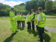 Pitlochry teens installing the hotels with Transport Scotland staff.
