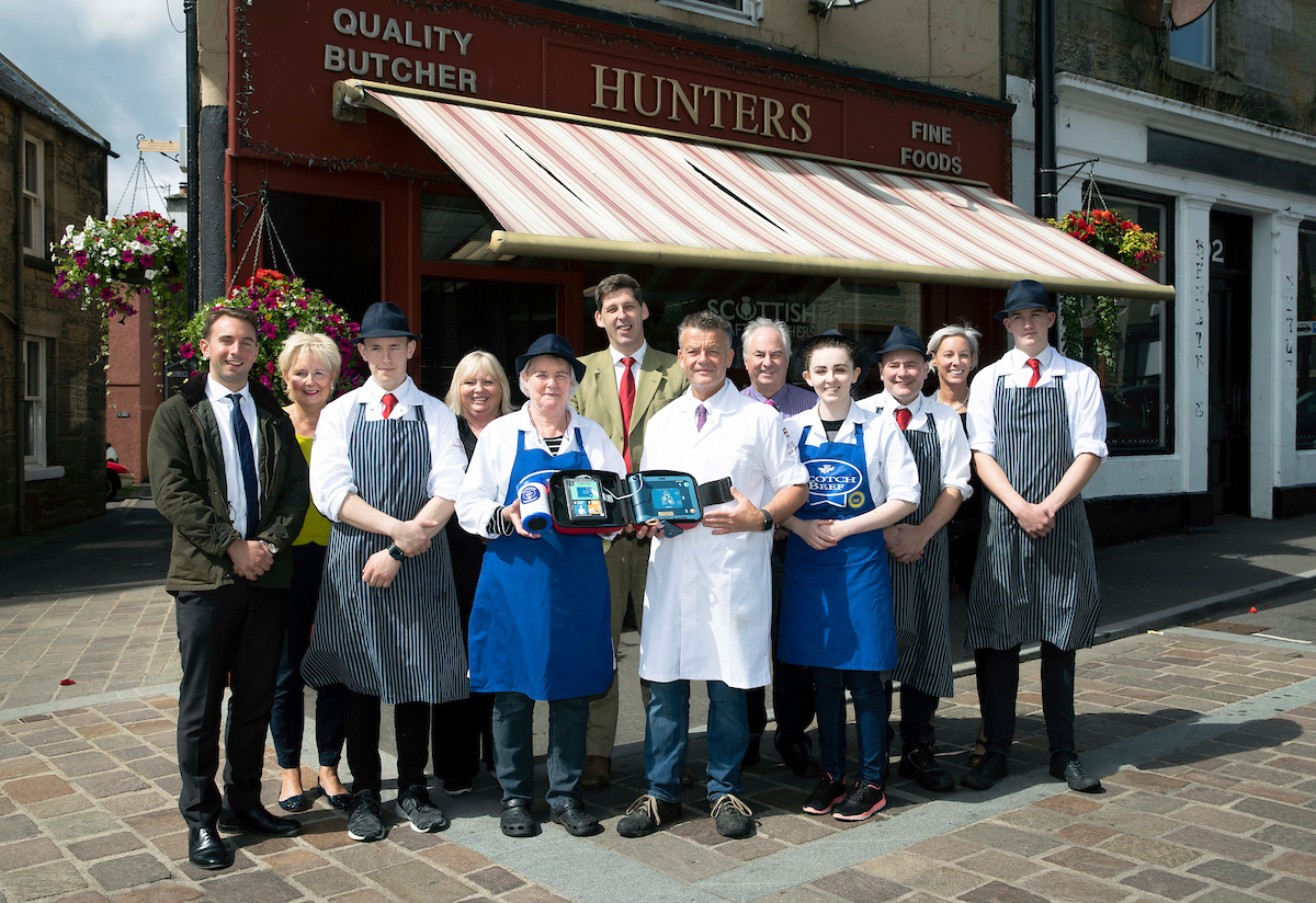 Lord Duncan (centre) during his visit to Hunters of Kinross.