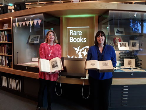 Sara on the left and Cassie with the book