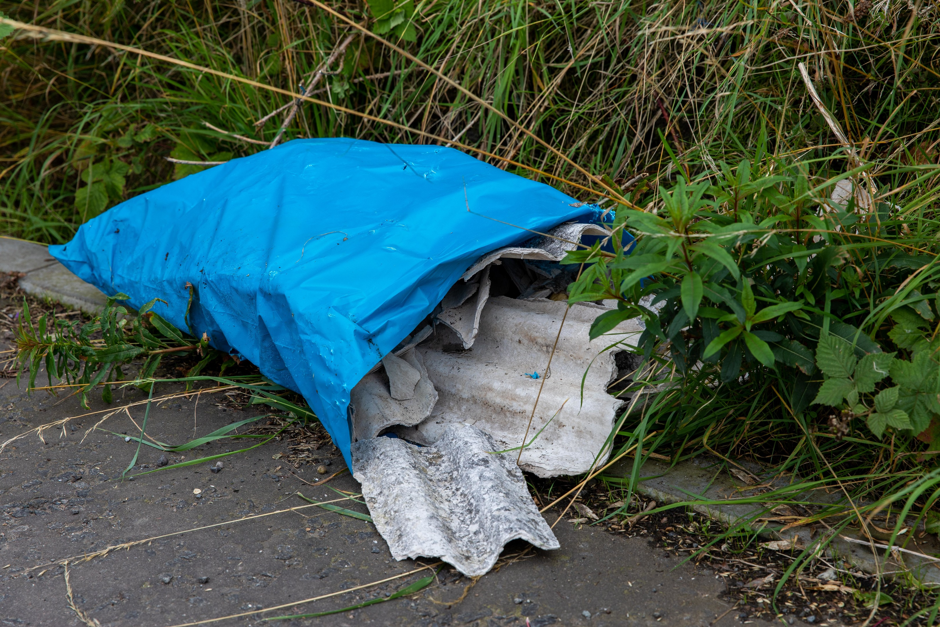 Rubbish dumped on the rural road was feared hazardous