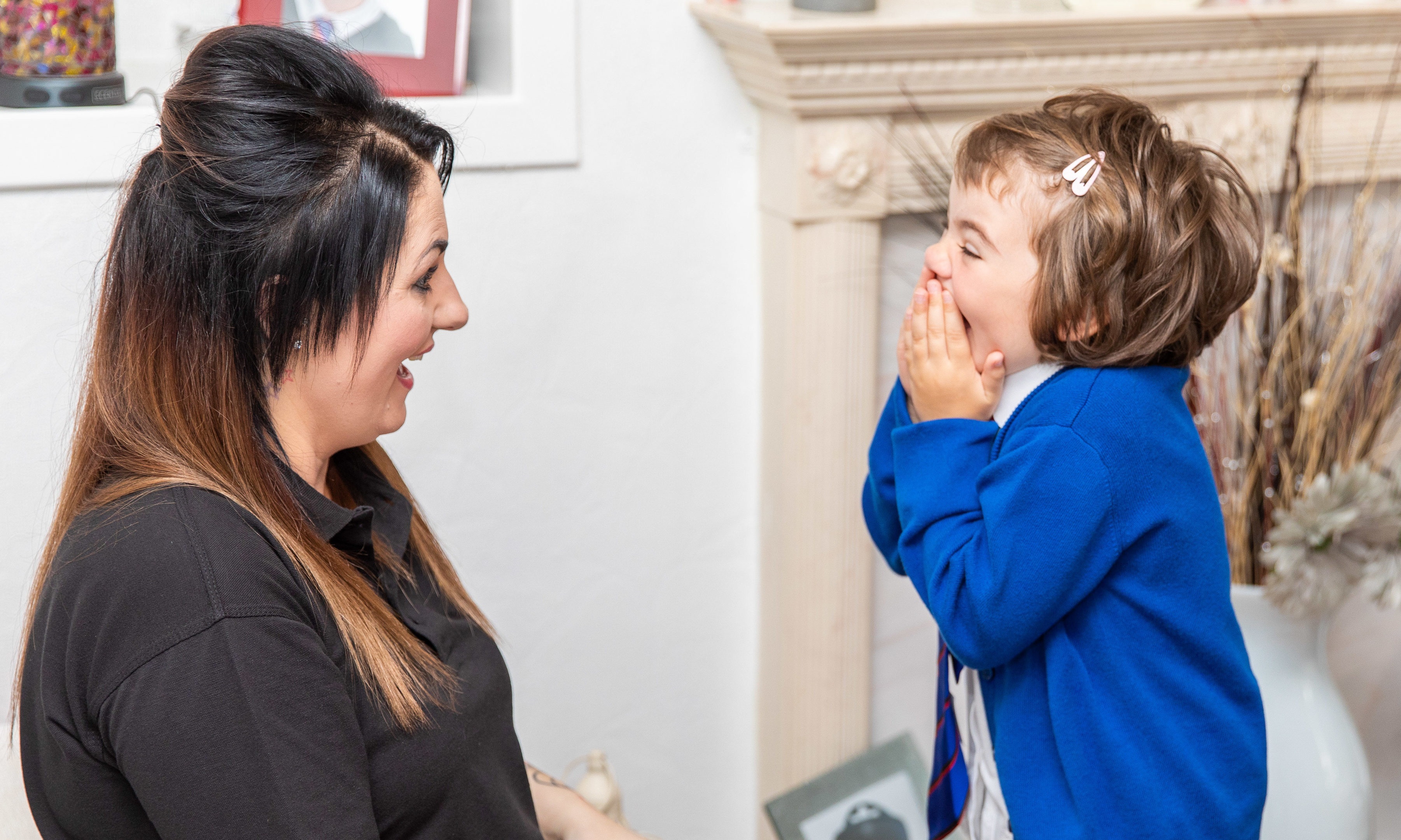 Ava getting ready for her first day at school with mum Marie.