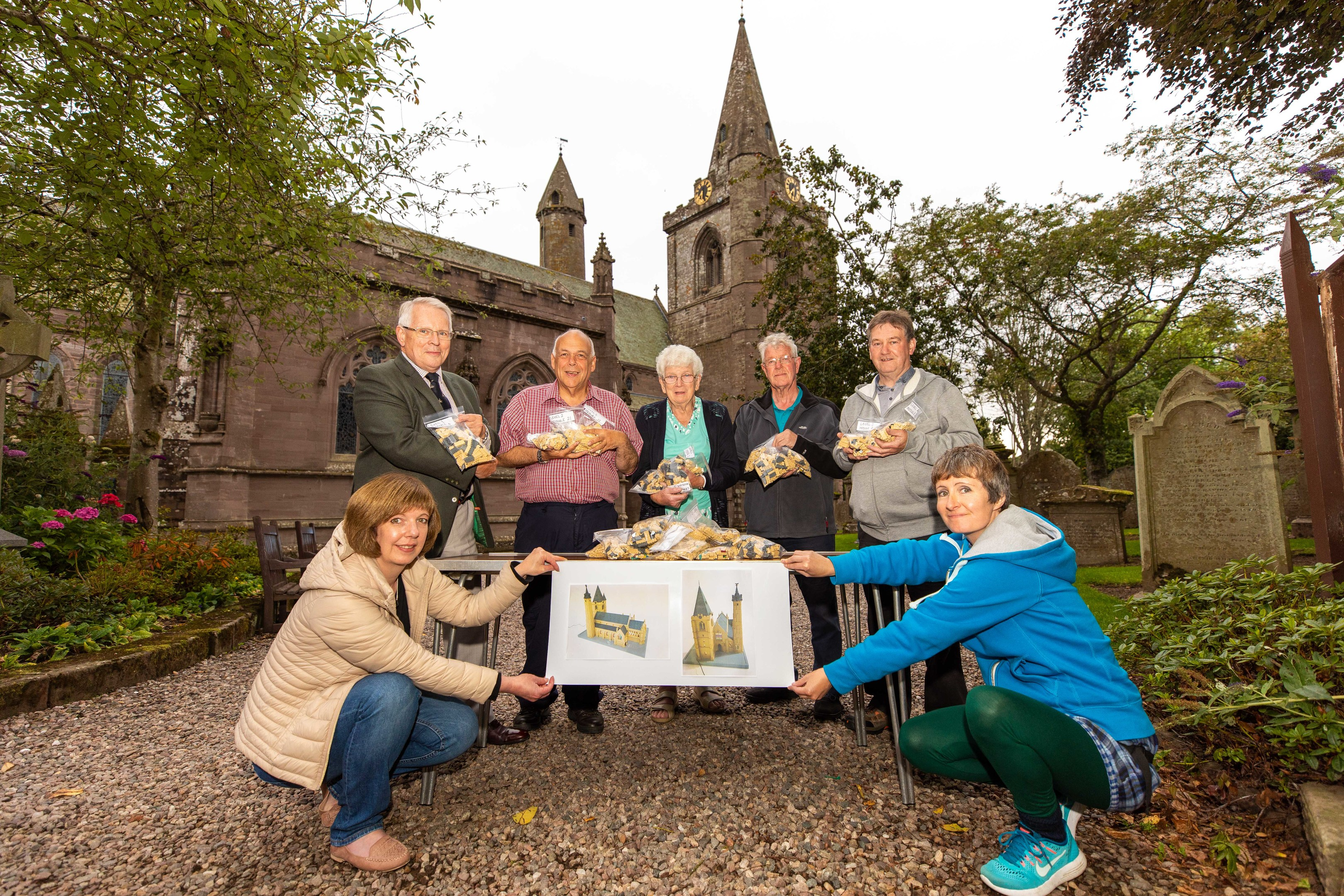 Claire Scrimgeour, Stanley Callaghan, Steve Dempsey, Irene Gillies, George Mitchell, Gordon Strachan and Caitlin McIlroy with the lego pieces to build the Lego Brechin Cathedral.