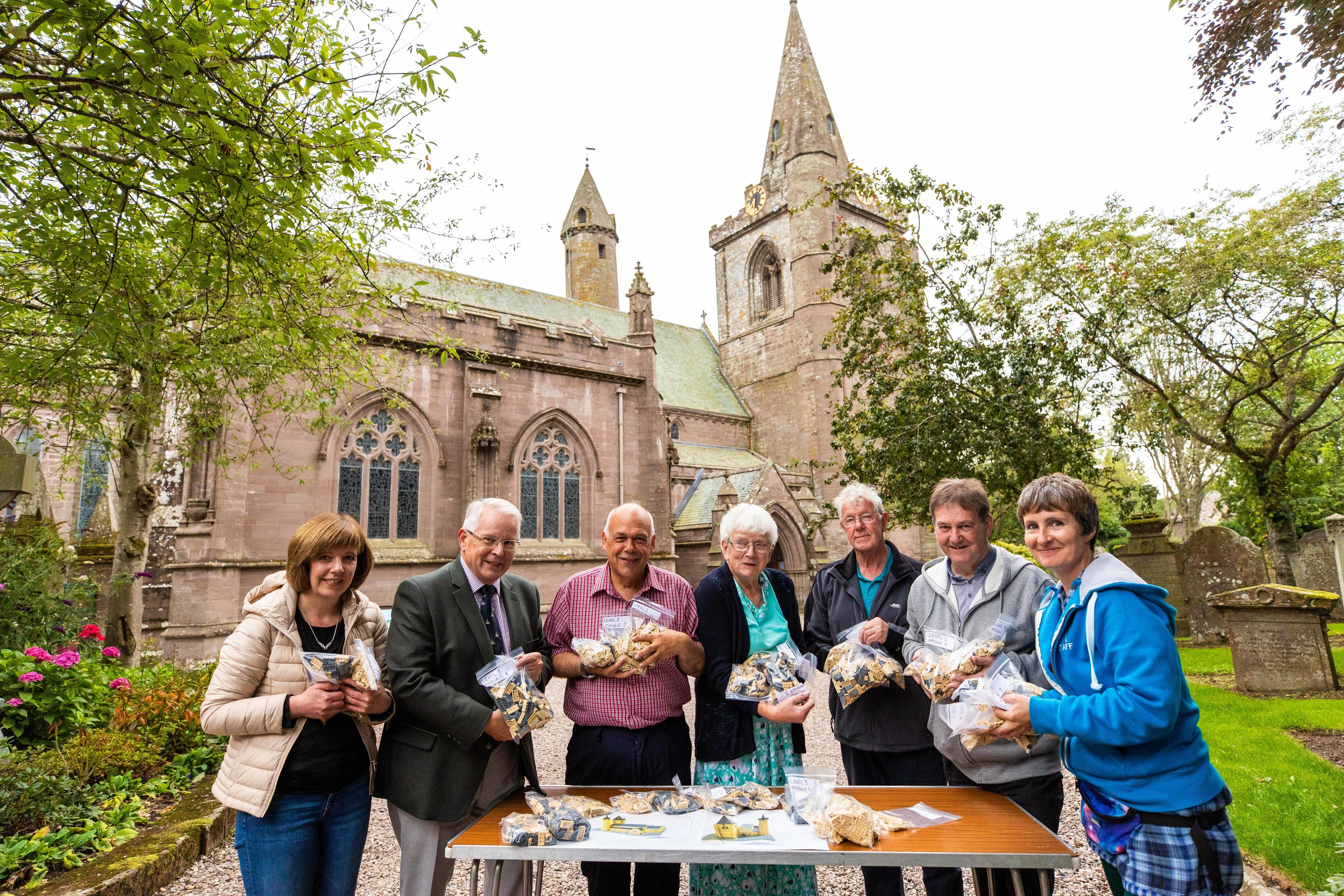 Claire Scrimgeour, Stanley Callaghan, Steve Dempsey, Irene Gillies, George Mitchell, Gordon Strachan and Caitlin McIlroy with the pieces to build the Lego Brechin Cathedral.
