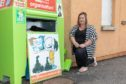 Administrator Lisa Gray at the clothing bin