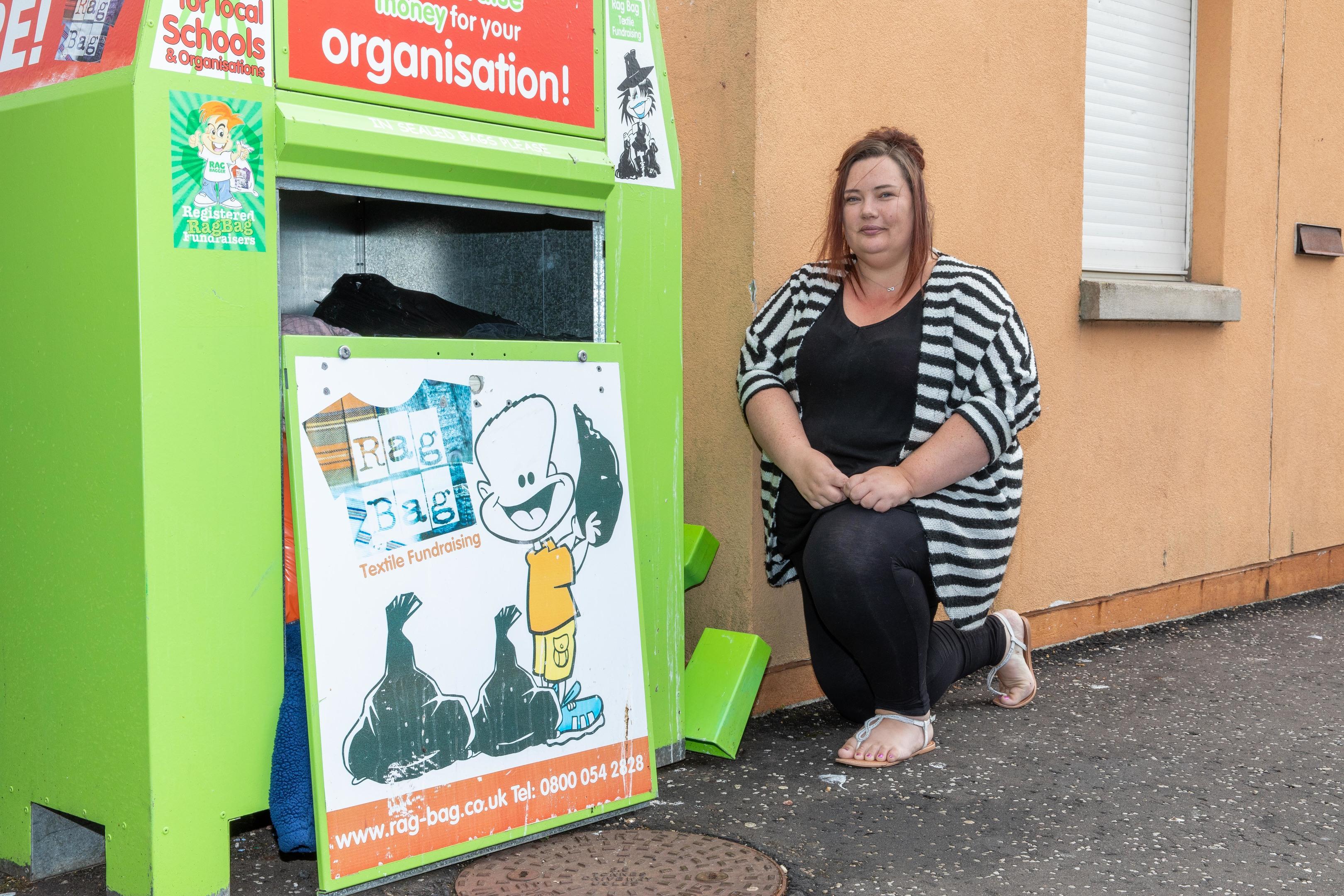 Administrator Lisa Gray at the clothing bin