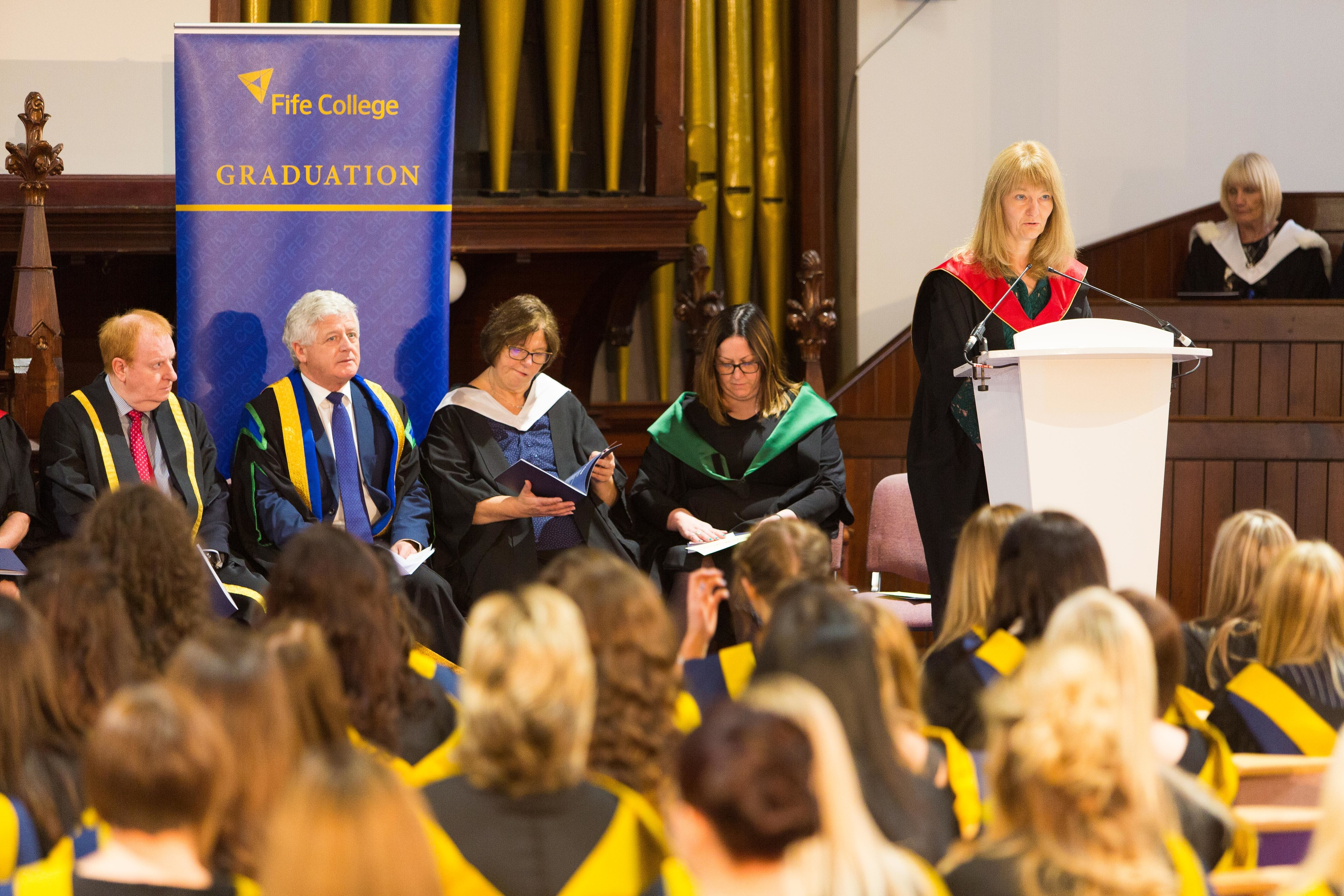 Dorothee Leslie addresses childcare and health students at a graduation at Fife College.