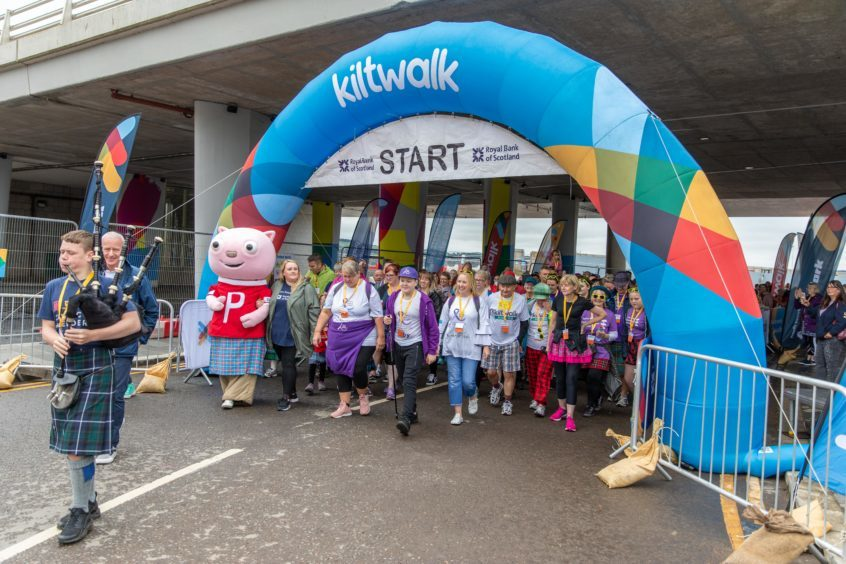Toby Etheridge, Alison Etheridge and Ruth Allen lead the Dundee Kiltwalk as they begin the Wee Wander at the Tay Road Bridge,