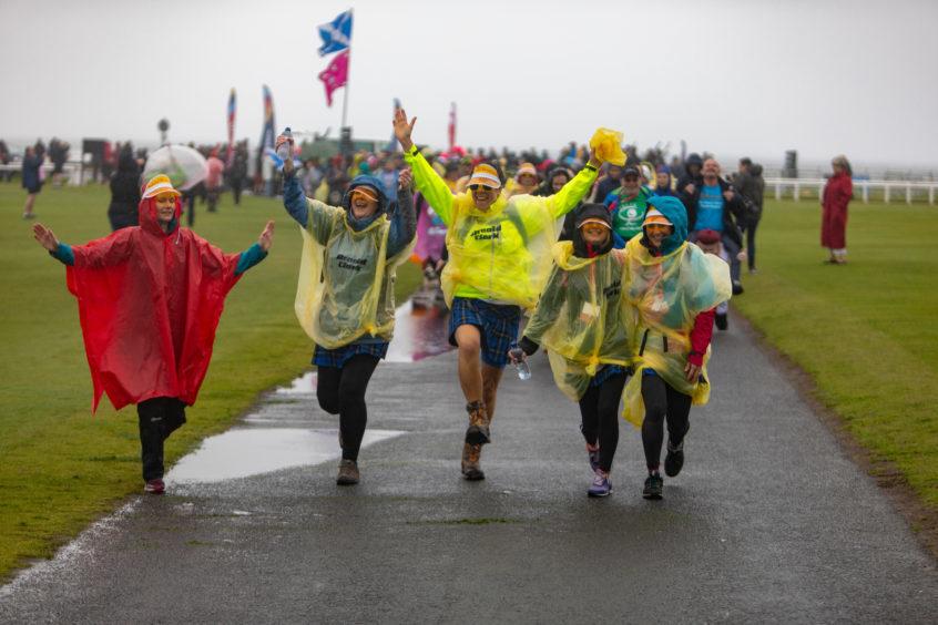 Kiltwalkers skipping as they begin the trek for charity.