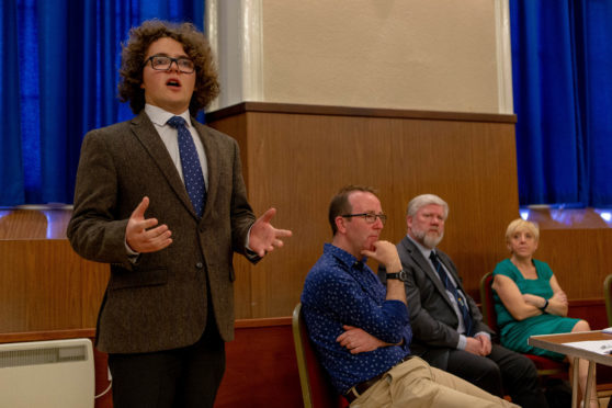 Councillor Dominic Nolan speaking at a recent public meeting.