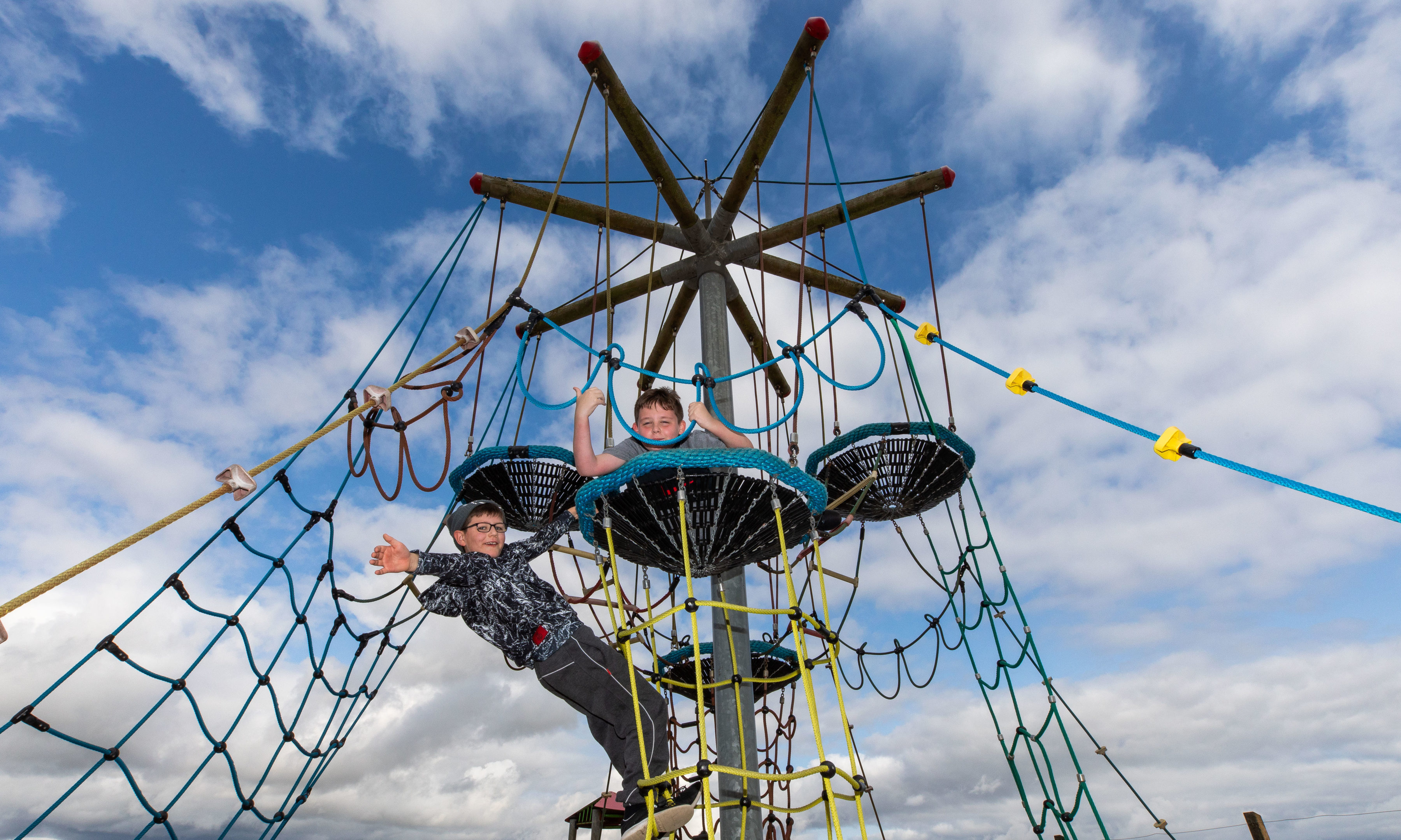 Friends Angus Muirhead (9) and Kyler Graham (9) play on the repaired cargo nets.