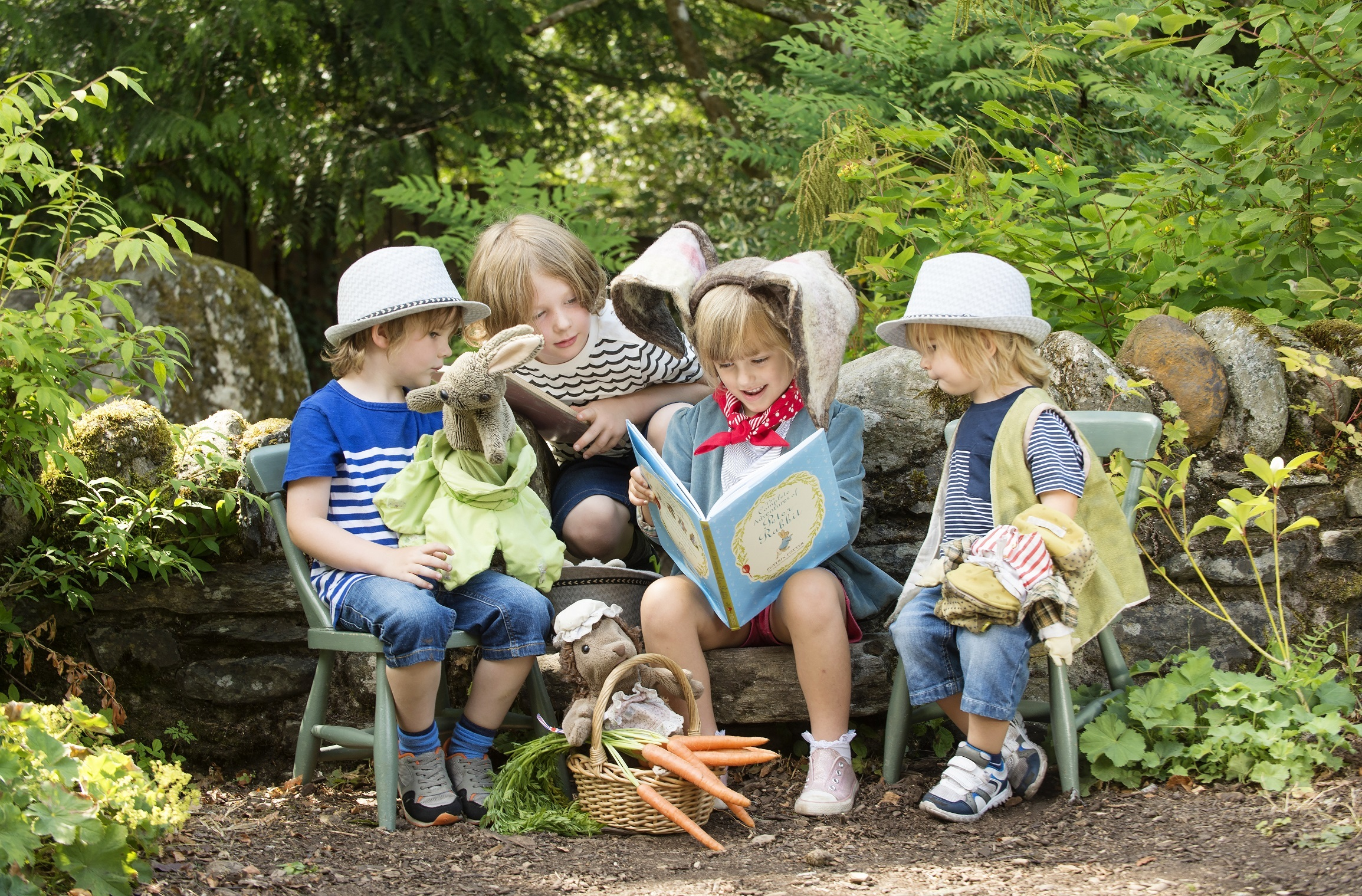 Children enjoying the map at the Beatrix Potter Exhibition and Garden at Birnam Arts, Perthshire.