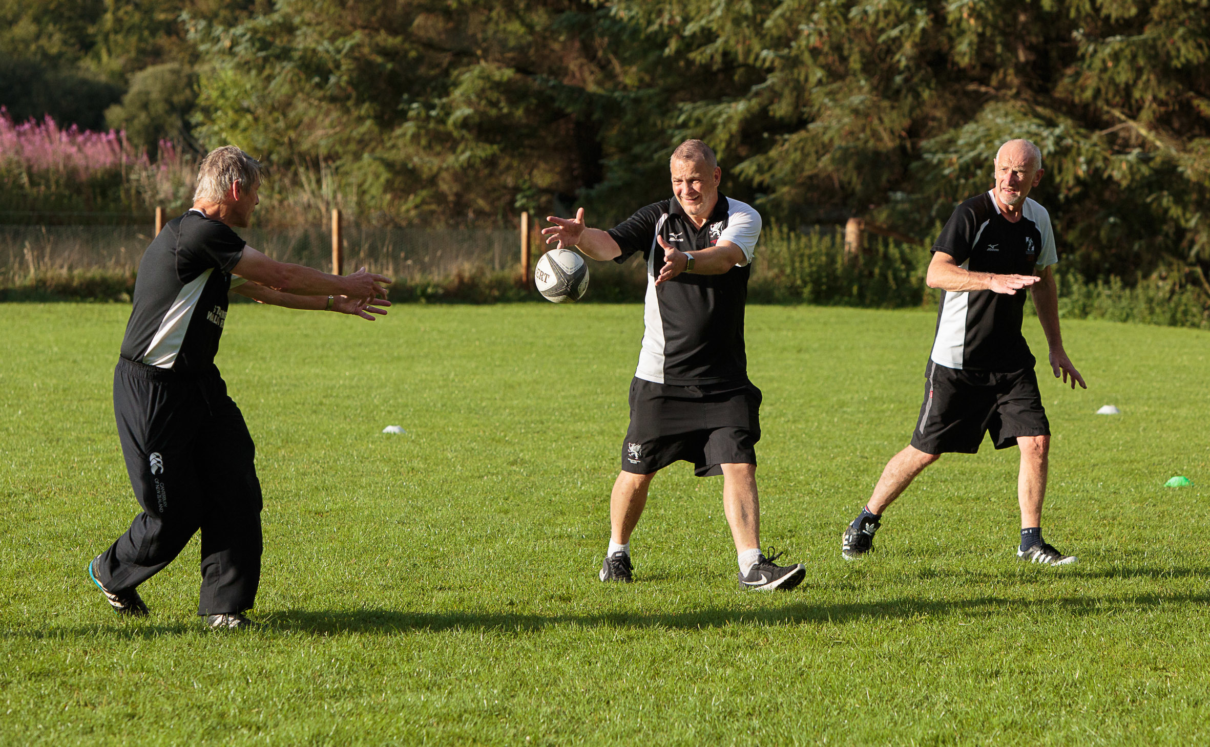 Simon Scott, 63, Bob Baldie, 51, and Willie Gray, 62, take part in a pilot walking rugby session at Strathmore