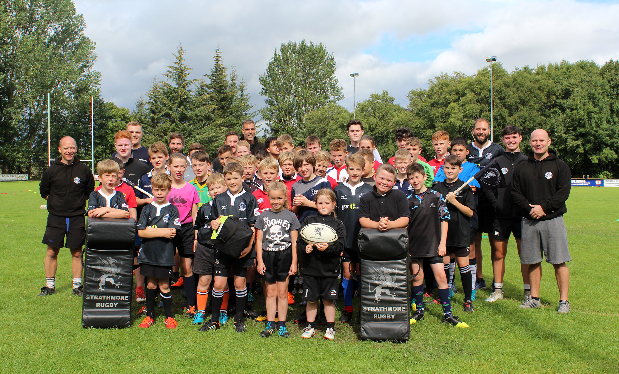 Strathie Sharks members and coaches with the SSEN-funded defibrillator
