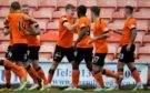 Paul Watson (centre) celebrates with his teammates after opening the scoring.