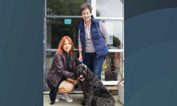 Julie McGrattan, Dusk and her owner, Jess Moran.