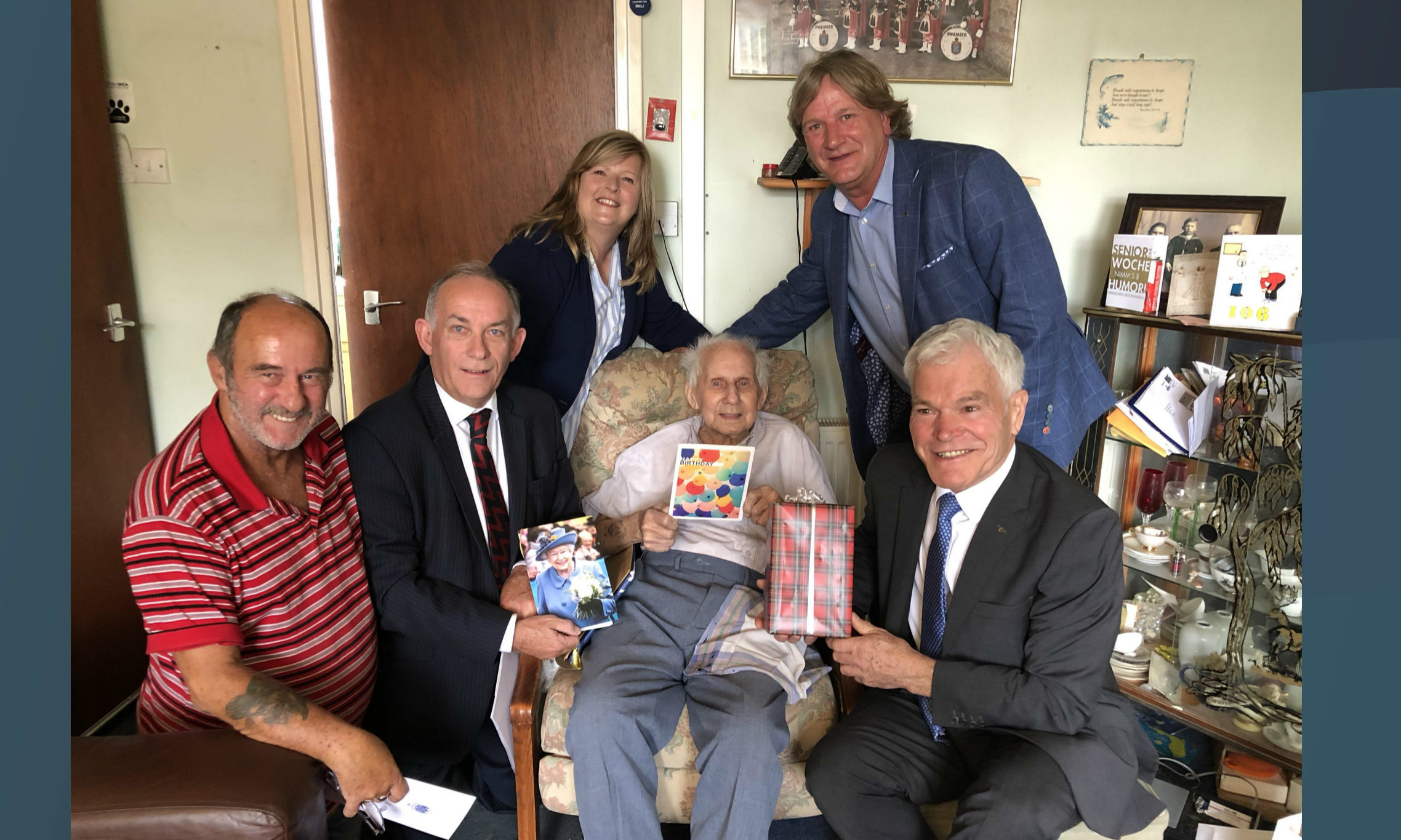 Jimmy, seated, is joined by his carer Archie Howie, Deputy Lieutenant of Fife Jim Kinloch, Councillor Carol Lindsay, David Torrance MSP and Fife Council's armed forces champion Councillor Rod Cavanagh.