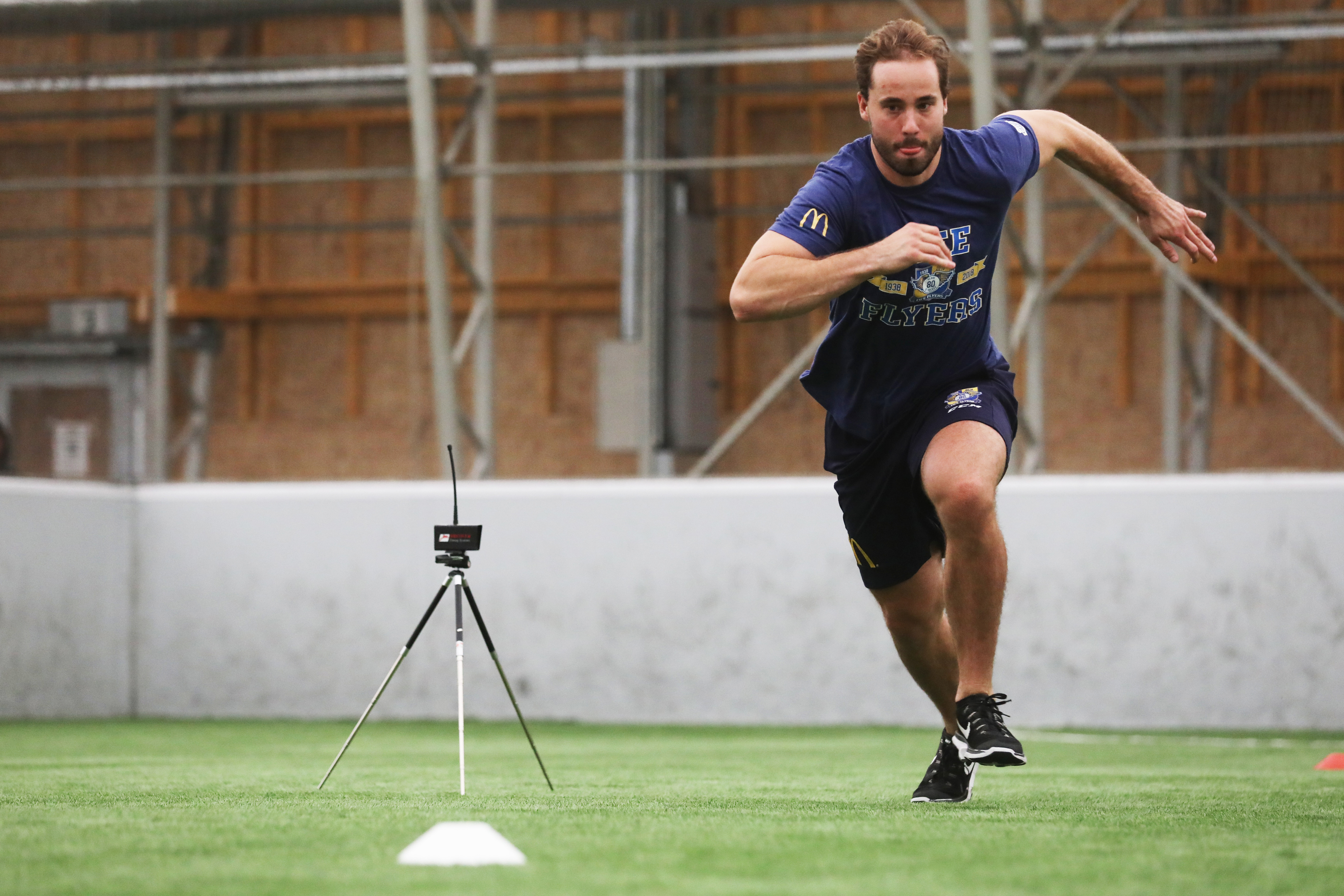 Brett Bulmer of Fife Flyers doing a fitness test drill with timing monitors.