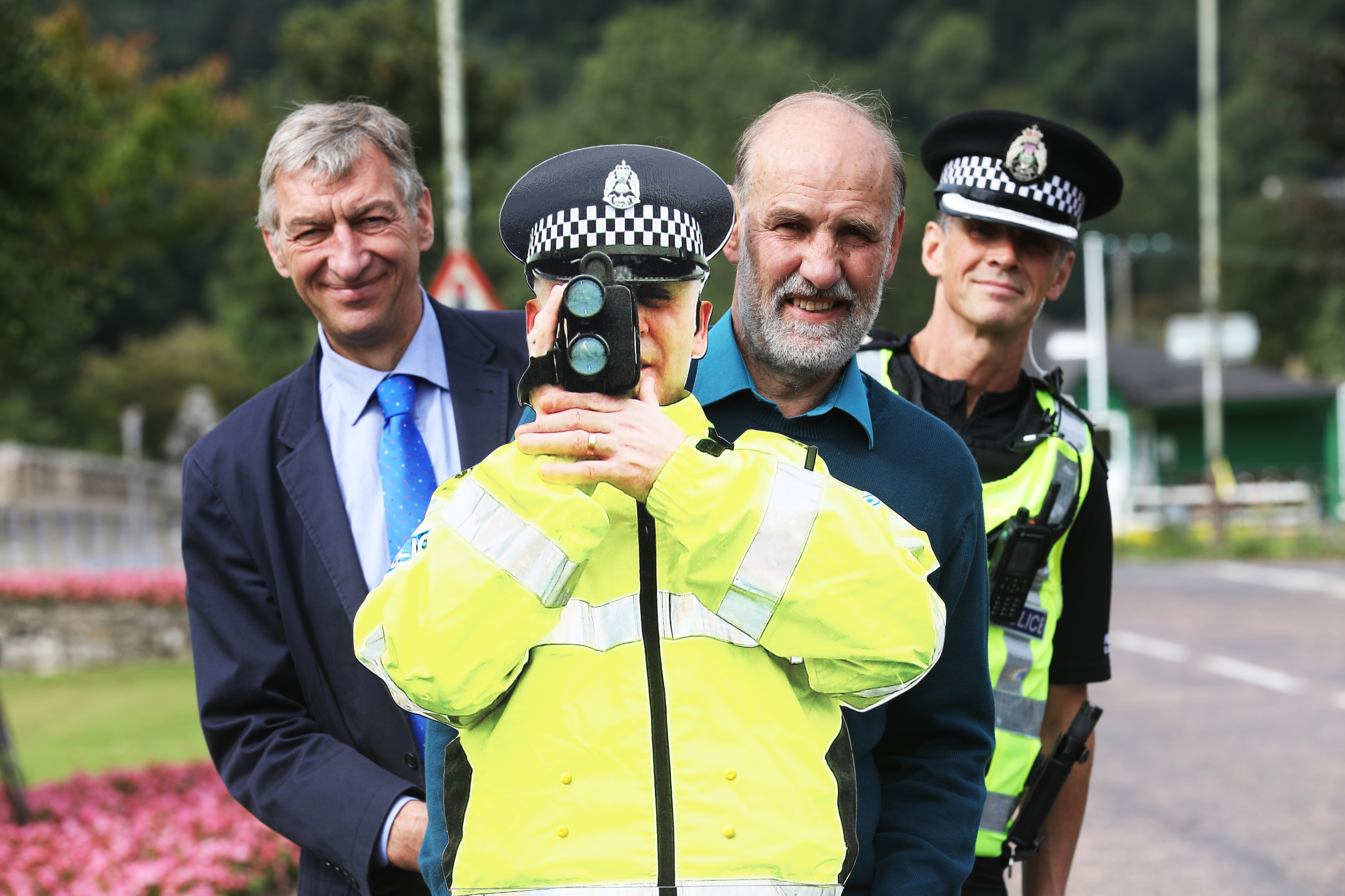 Councillor for the Highland Ward Mike Williamson, Pat Spicer of the Aberfeldy Community Council and Gordon Thomson of Police Scotland with  Pop Up Jim.