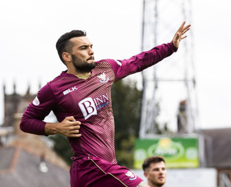 Tony Watt celebrates his opening goal against Queen of the South.