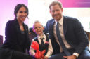 Prince Harry, Duke of Sussex and Meghan, Duchess of Sussex meet four-year-old Mckenzie Brackley during the annual WellChild awards at Royal Lancaster Hotel on September 4, 2018.
