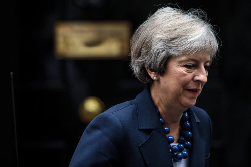 Theresa May leaves Downing Street.