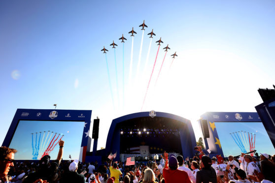 The Patrouille de France fly over during the opening ceremony for the 2018 Ryder Cup at Le Golf National.