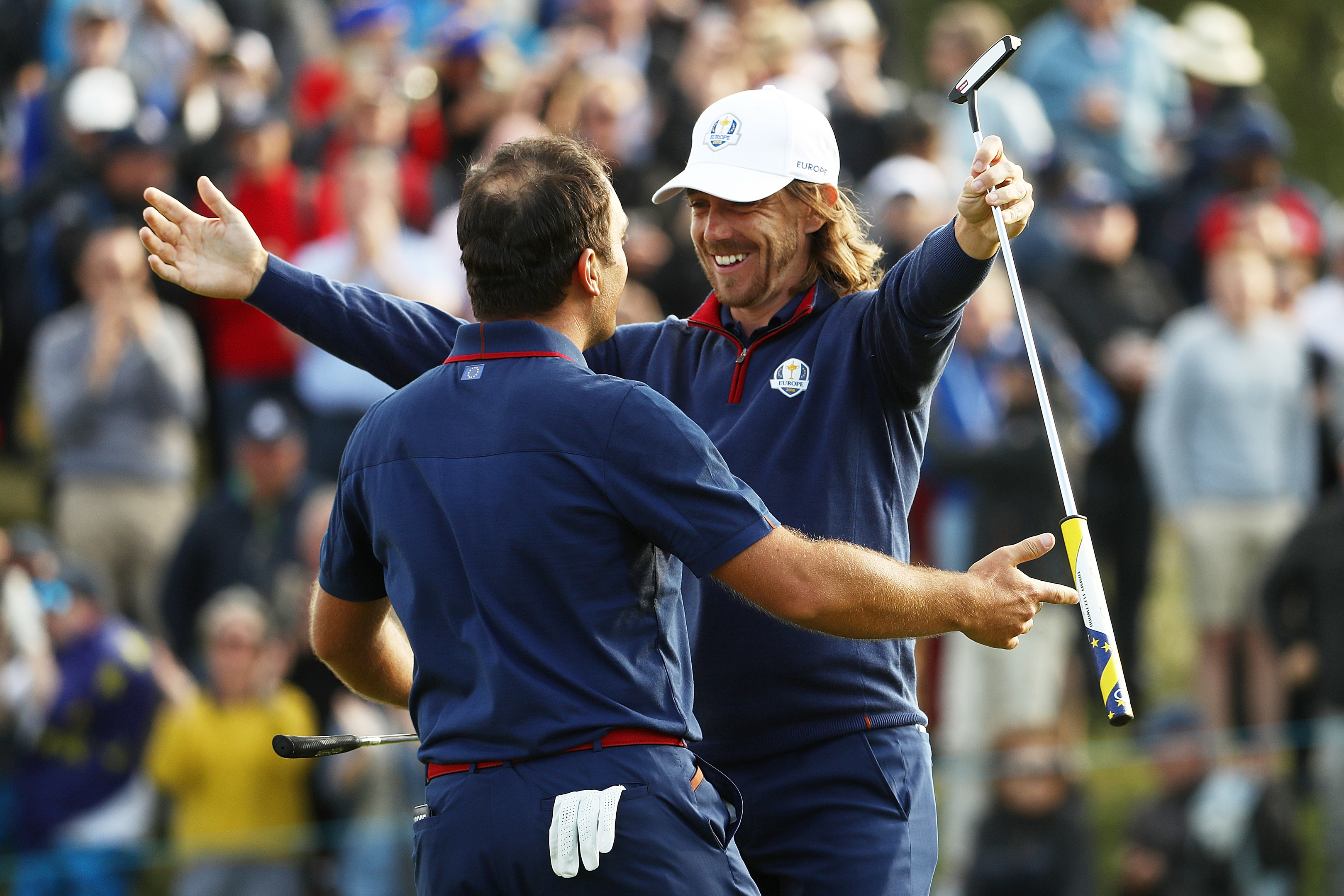 Francesco Molinari and Tommy Fleetwood celebrate after completing the 4-0 foursomes whitewash for Europe in the Ryder Cup in Paris.