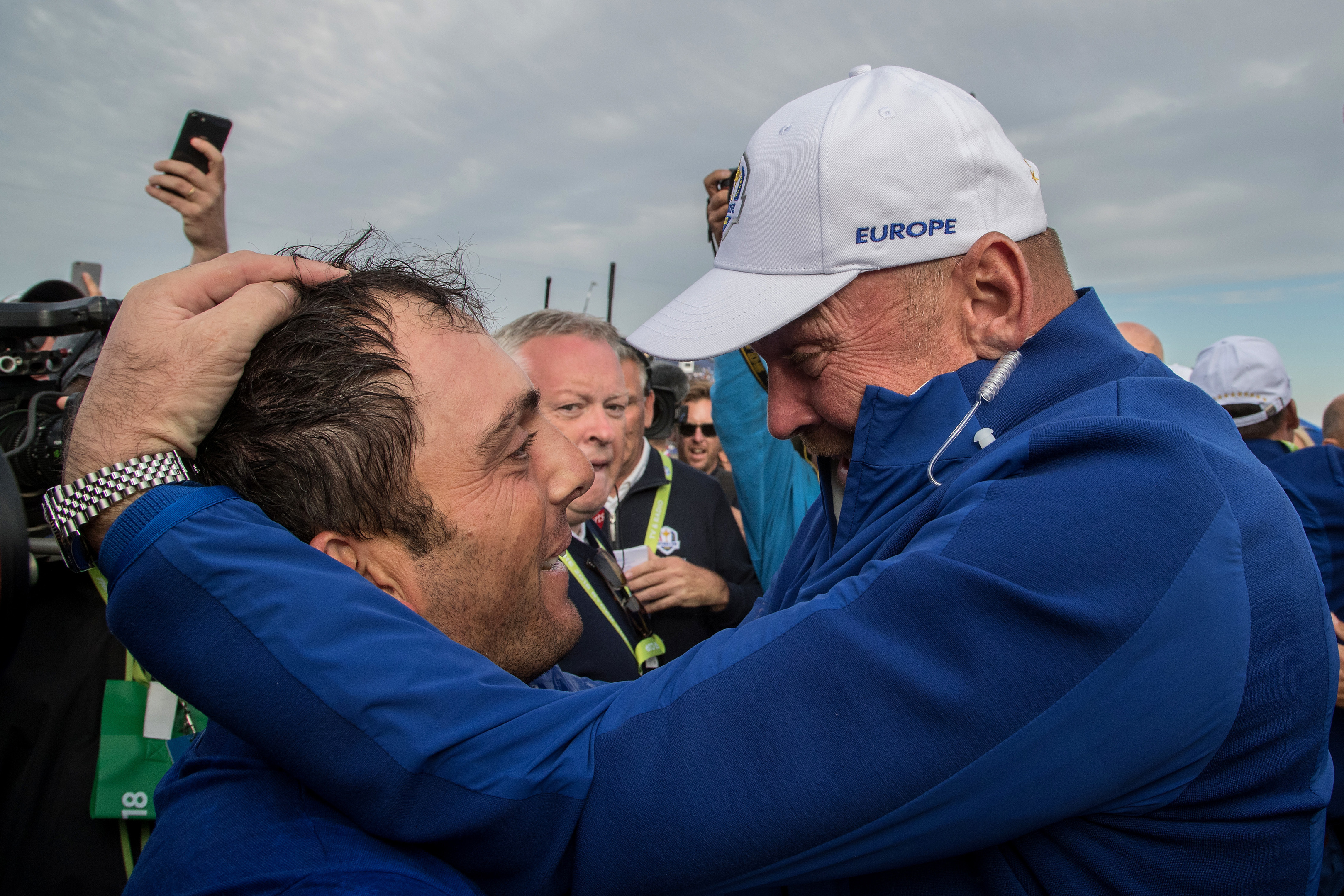 Captain Thomas Bjorn hugs Francesco Molinari as he secures the winning point to take the victory during the singles matches of the 2018 Ryder Cup.