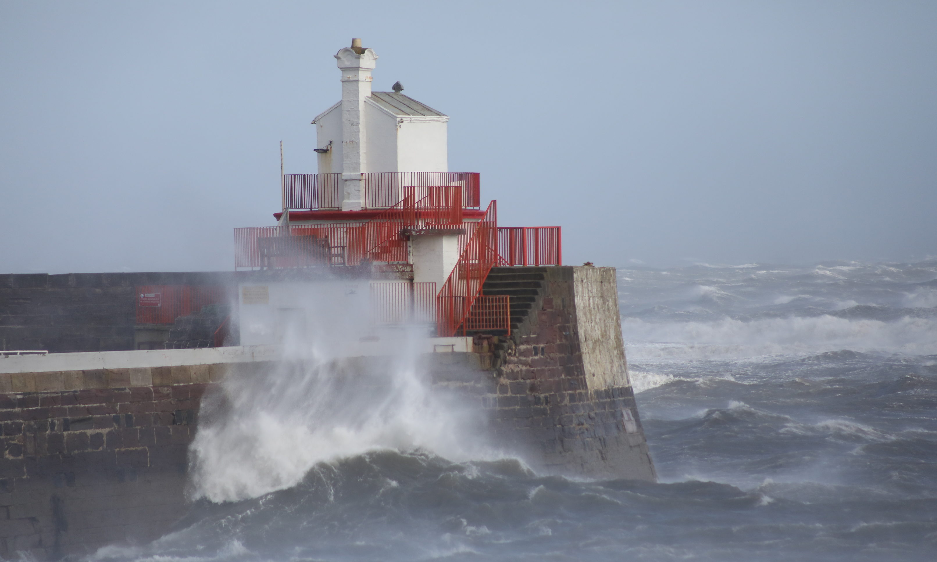 Waves battering the harbour wall at Arbroath.
