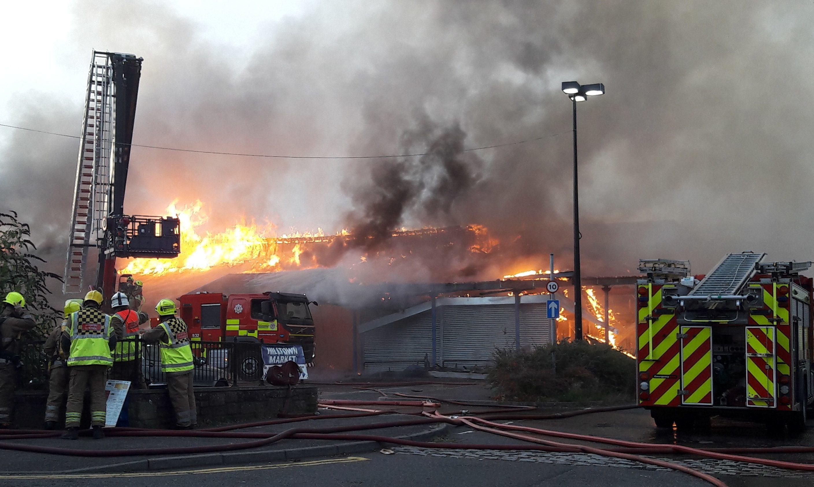 Fire crews tackling the Hilltown blaze.
