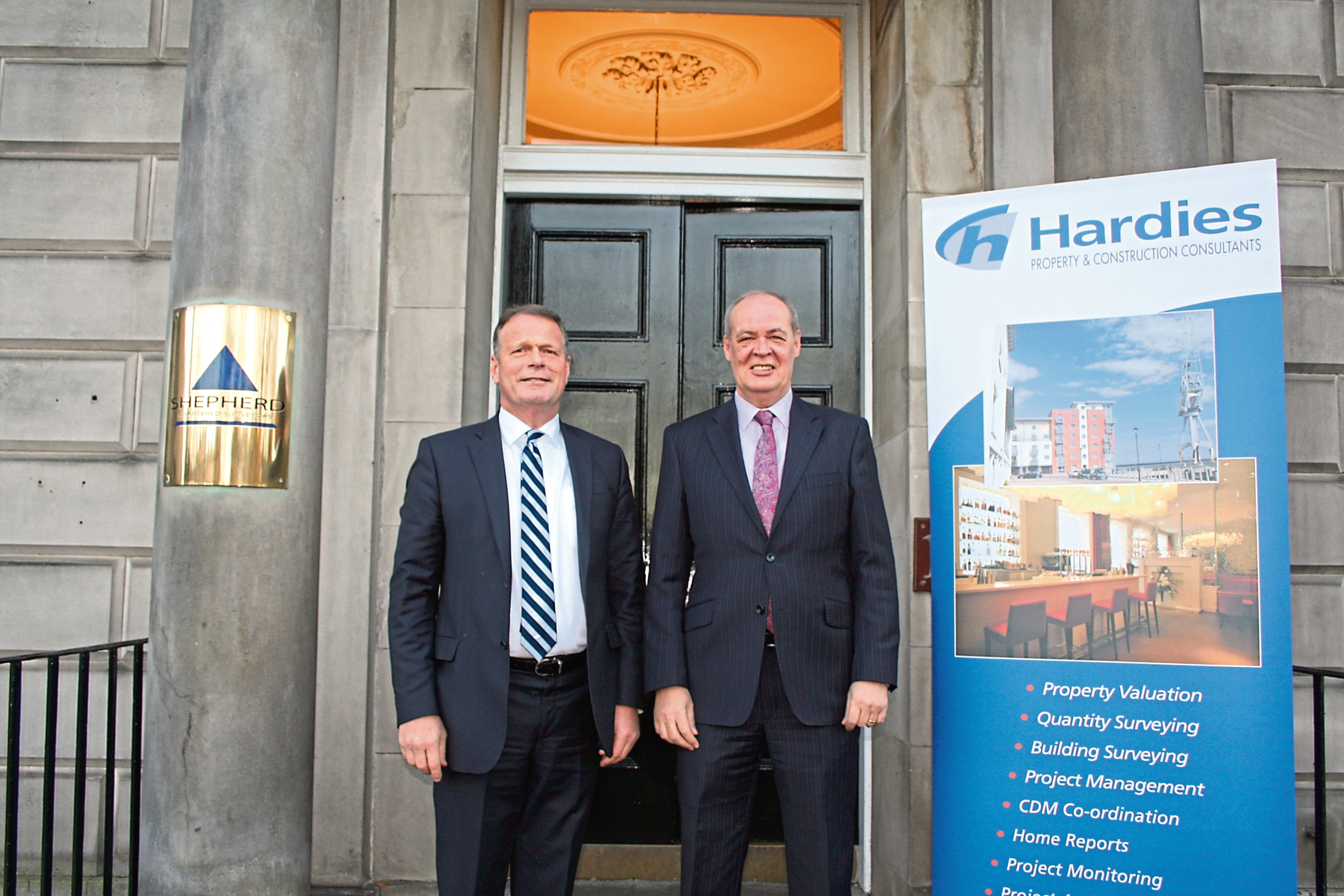 Shepherd senior partner George Brewster (left) with Derek Ferrier, managing partner of Hardies.